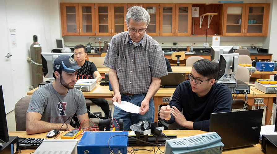 Students and professor work in the lab